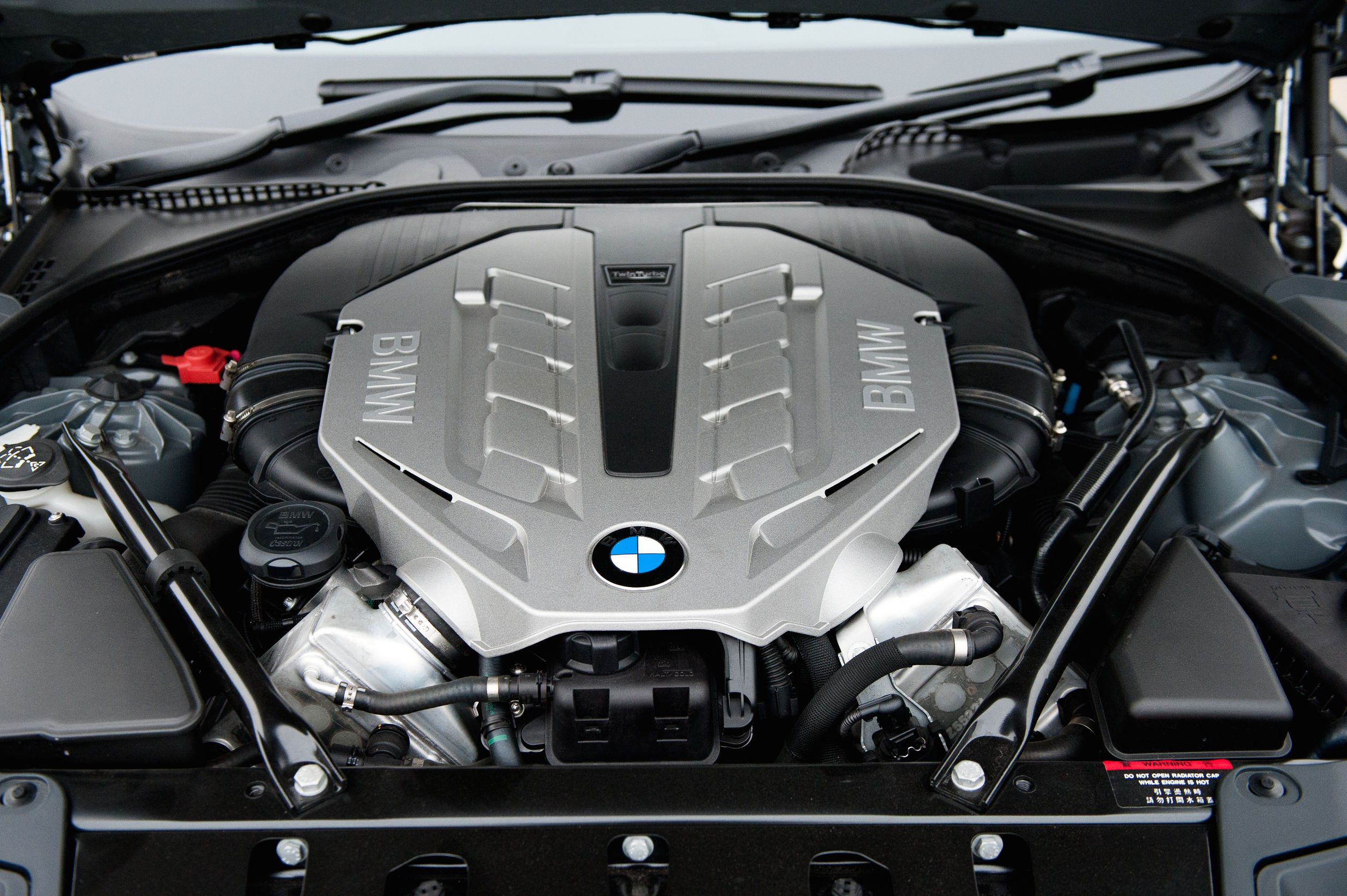 close up of bmw engine with bmw logo. Cars Review. Best American Auto & Cars Review